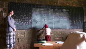 A child teaching math at Muruguma Primary School