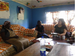 Mireyne performing the questionnaire in one of the women's homes.
