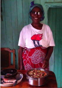 Salome (member of joy women's group) besides her specially prepared githeri, which has more beans to increase protein and carrots and green leafy vegetables to increase β- carotene or vitamin A, folate and iron.