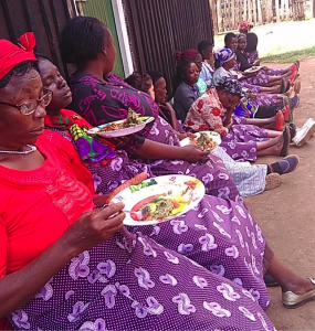Women from Joy Women's group enjoying super githeri and super mukimo that they prepared.